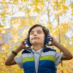 photo-of-a-boy-listening-in-headphones